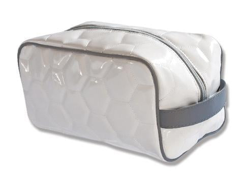 A white soccer dopp kit/ Toiletry bag w/ grey trim made of real Soccer material.