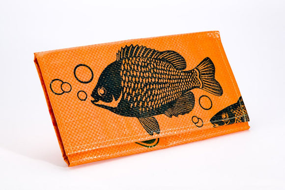 A large bi-fold wallet made w/ recycled materiel w/ tangerine fish pattern.