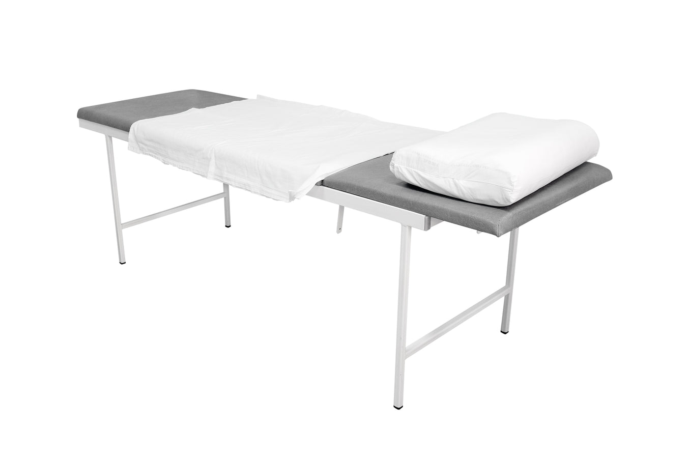 Medical examination couch with white sheet and pillow