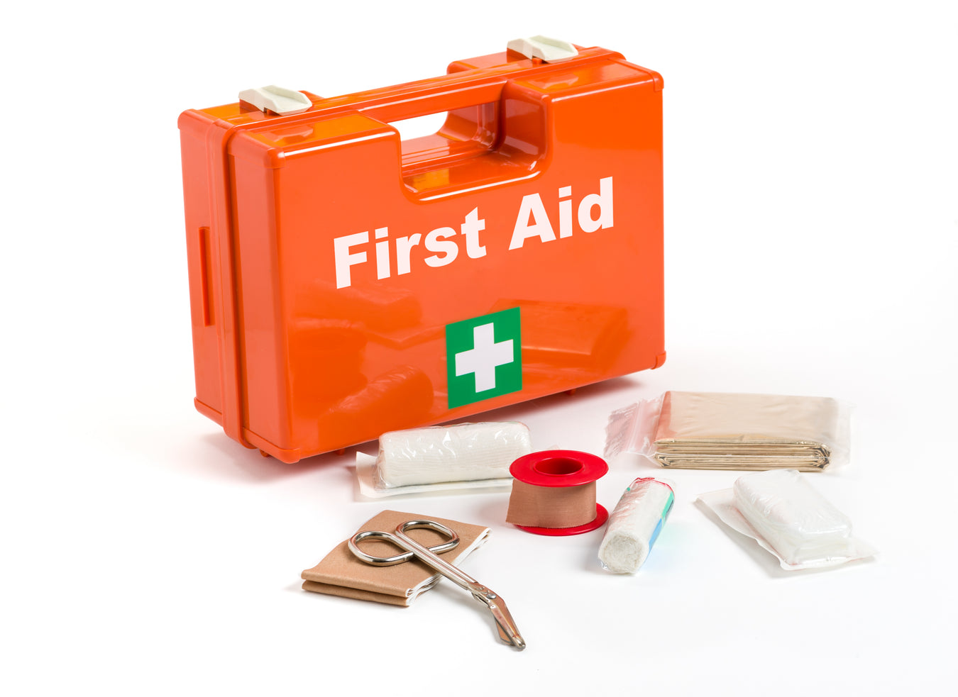Bright orange first aid kit box with content laid out