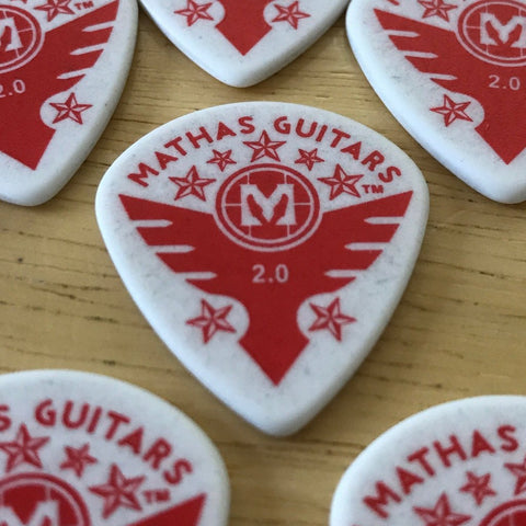 "Mathas Guitars - Guitar Picks - 2.0 mm ""Jazz Maxx"" WHITE - ""Stars & Flight"" Logo - Red Graphics"