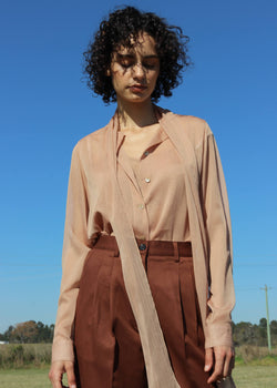 Maya wears the Amber Pussy-bow Blouse & Cami Set in Caramel Stripe by Laundromat