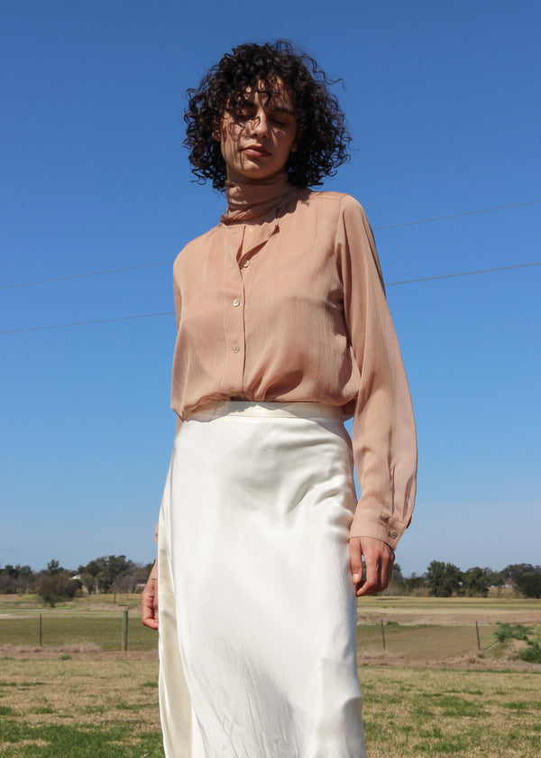 Maya wearing the Amber Pussy-bow Blouse with skirt, both from Laundromat