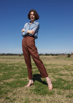 Olivia wears the Daria Wool Pleat Trousers from Laundromat