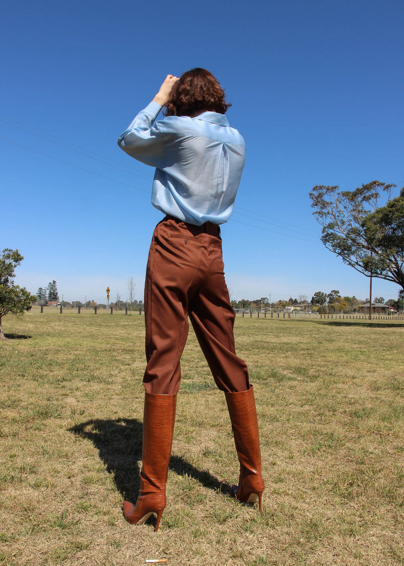 Back of the Daria Wool Pleat Trousers in Walnut from Laundromat