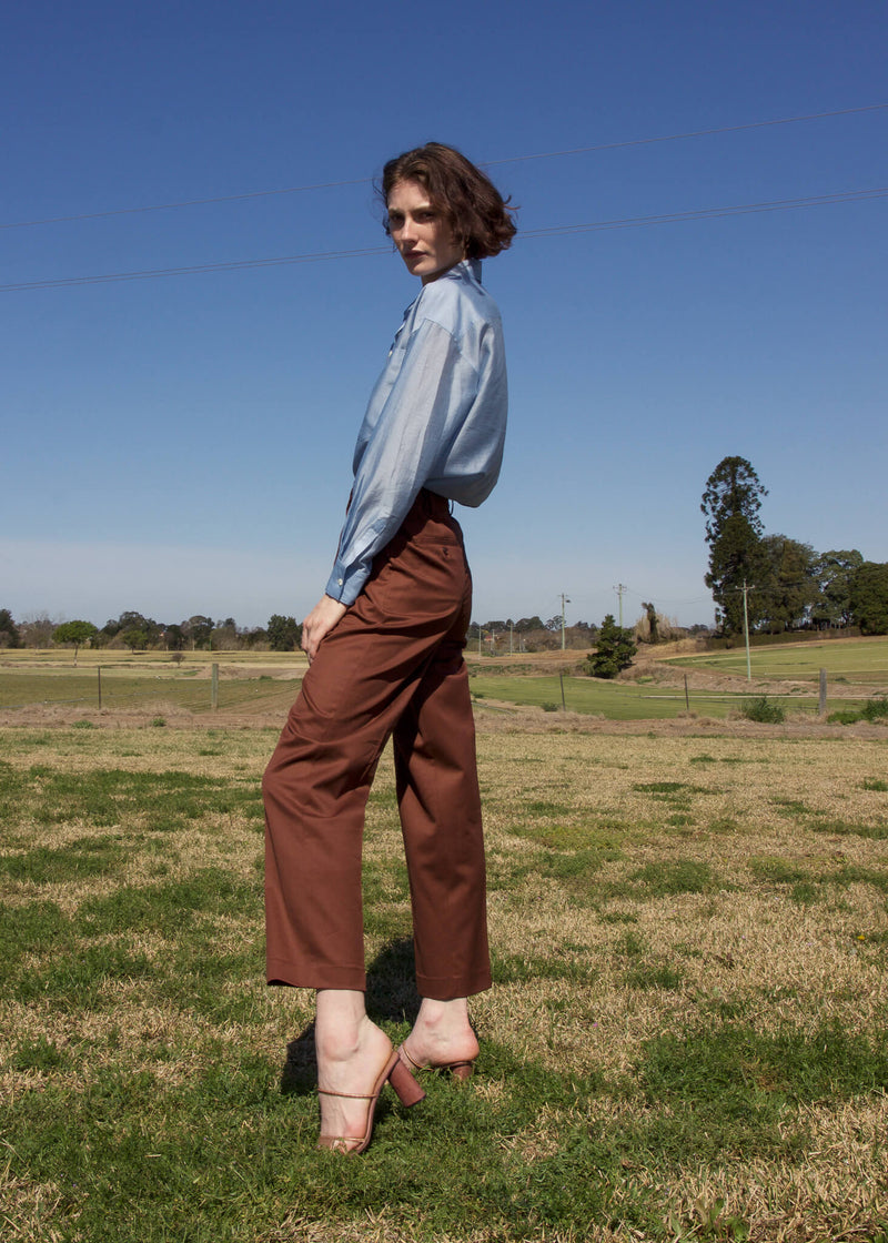 Olivia wears the Daria Wool Pleat Trousers in Walnut