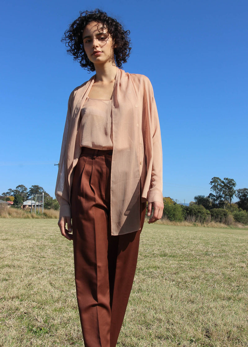 Maya wears the Daria Wool Pleat Trousers with blouse, both from Laundromat