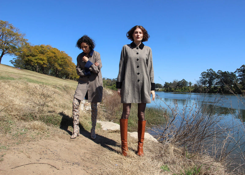 Maya and Olivia both wearing the Edie Wool Car Coat by the river