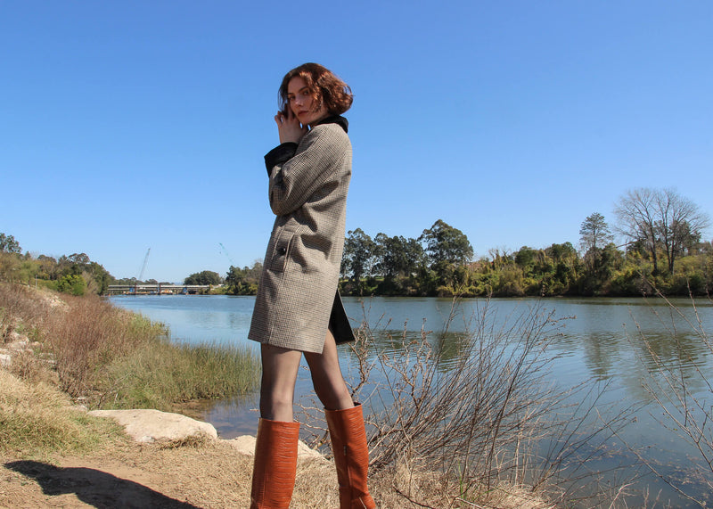 Olivia by the river wearing the Edie Wool Car Coat