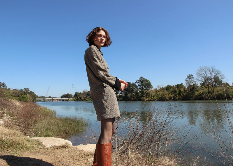 Olivia wears the Edie Wool Car Coat in Chestnut by Laundromat