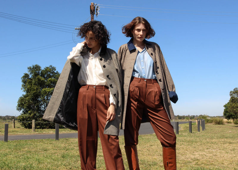 Maya and Olivia wearing the Edie Wool Car Coat with wool trousers, all from Laundromat