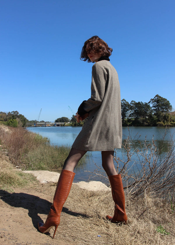 Back view of the Edie Wool Car Coat worn by Olivia from Laundromat