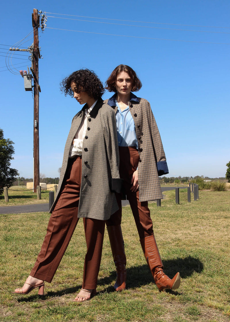 Maya and Olivia both wearing the Edie Wool Car Coat from Laundromat