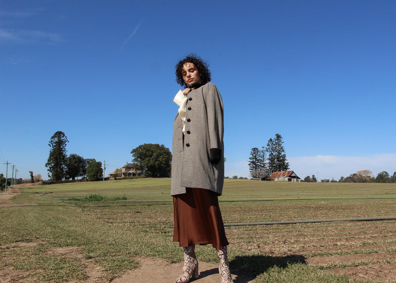 Maya wearing the Edie Wool Car Coat in Chestnut Houndstooth from Laundromat