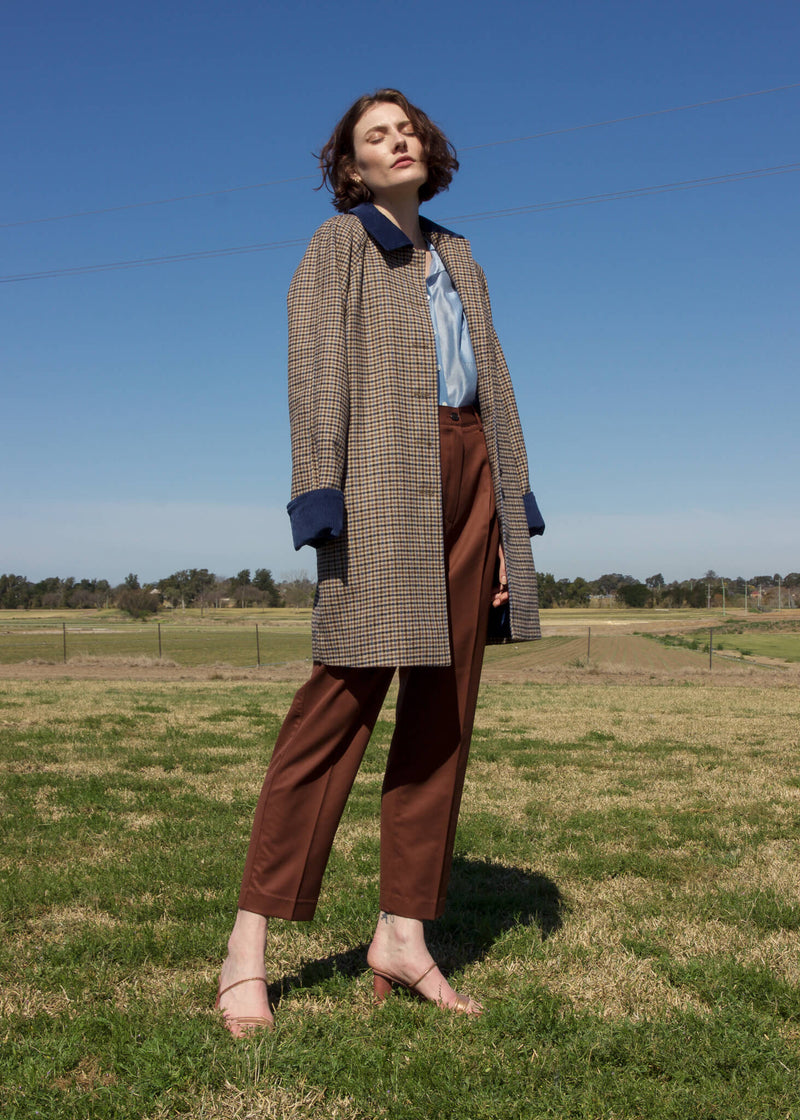 Olivia wears the Edie Wool Car Coat in Turkish Blue Houndstooth by Laundromat