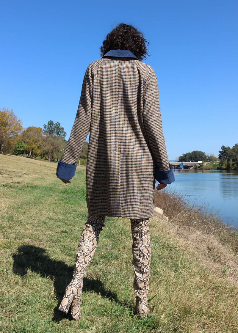 Back of Maya wearing the Edie Wool Car Coat from Laundromat
