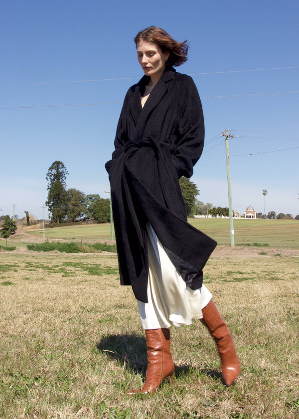 Olivia wears the Kasia Llama Wool Coat in Caviar from Laundromat
