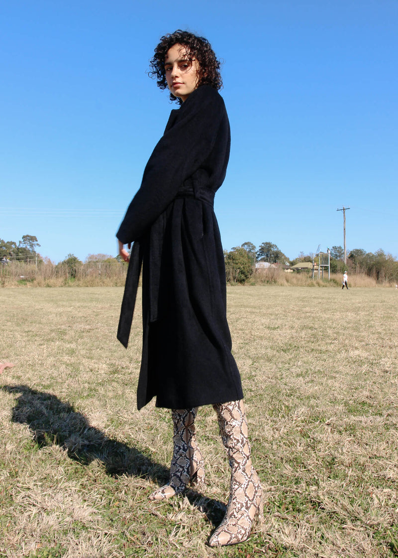Maya wearing the Kasia Llama Wool Coat by Laundromat