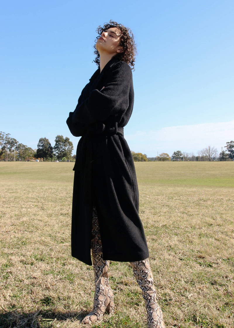 Maya wears the Kasia Llama Wool Coat in Caviar