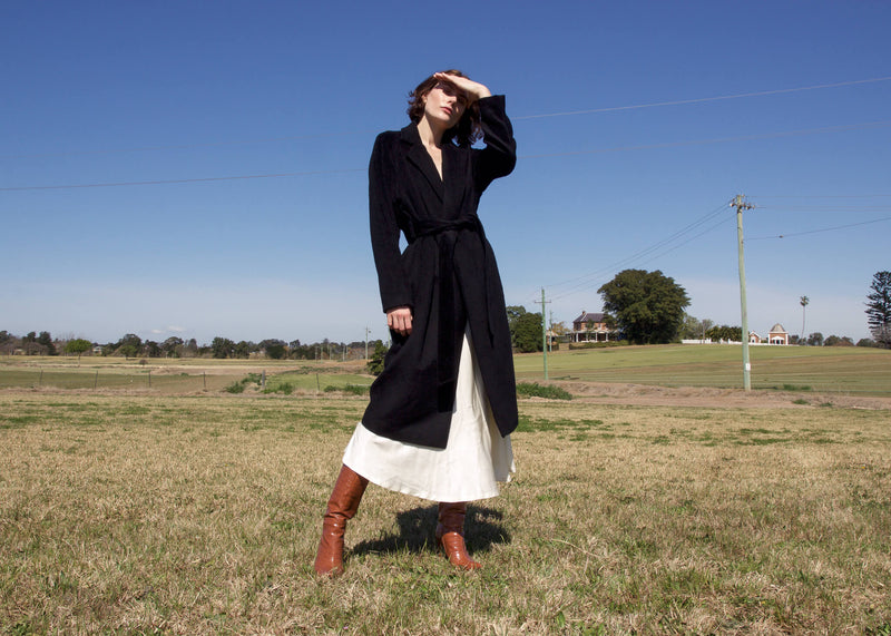 Olivia in a paddock wearing the Kasia Llama Wool Coat by Laundromat