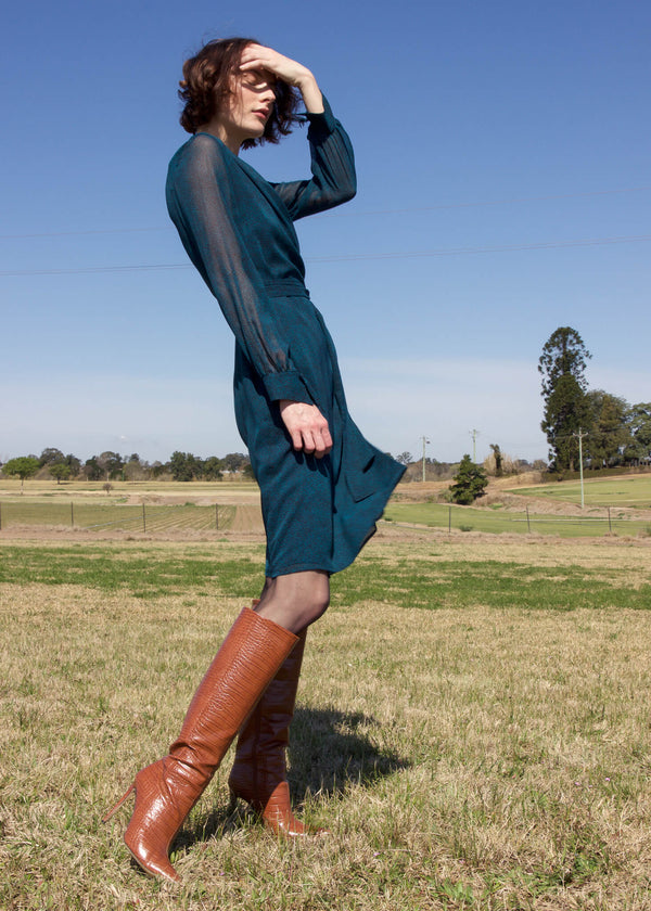 Olivia wears the Laila Chiffon Wrap Dress in Bottle Green by Laundromat