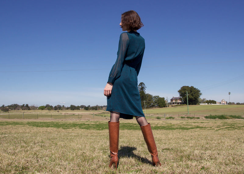 Back view of the Laila Chiffon Wrap Dress in Bottle Green from Laundromat