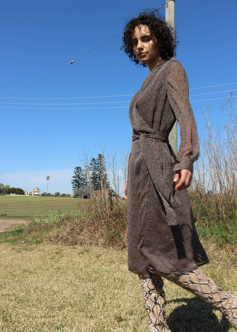 Maya wears the Laila Chiffon Wrap Dress from Laundromat