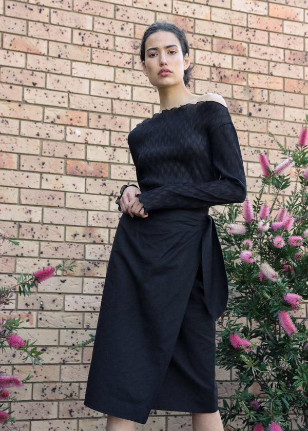 India wears the Anais Wrap Skirt in Ink with front ties by Laundromat