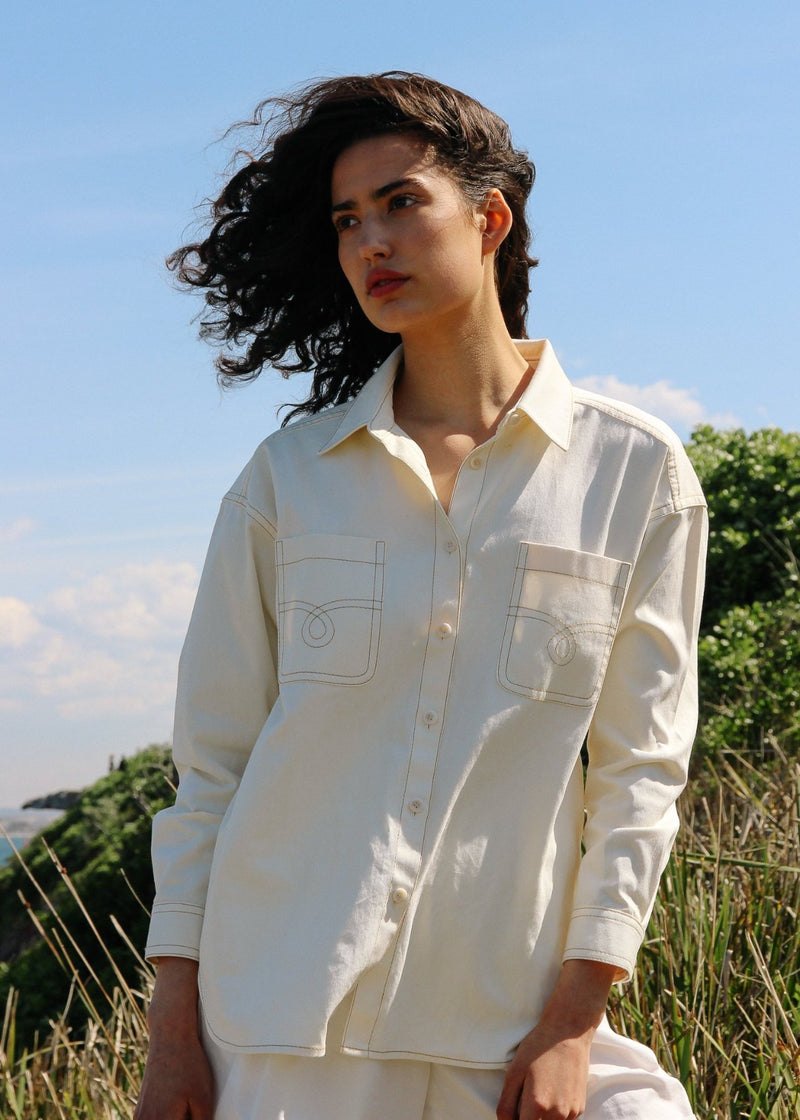 India wearing the Anouk Denim Shirt in Double Cream from Laundromat