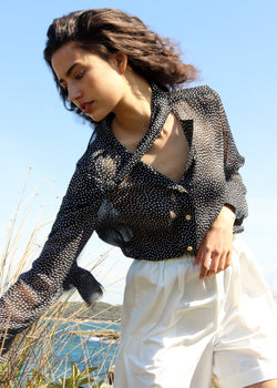 India wears the Carmen Pussy-bow Blouse in Dalmatian with loose neck-ties from Laundromat