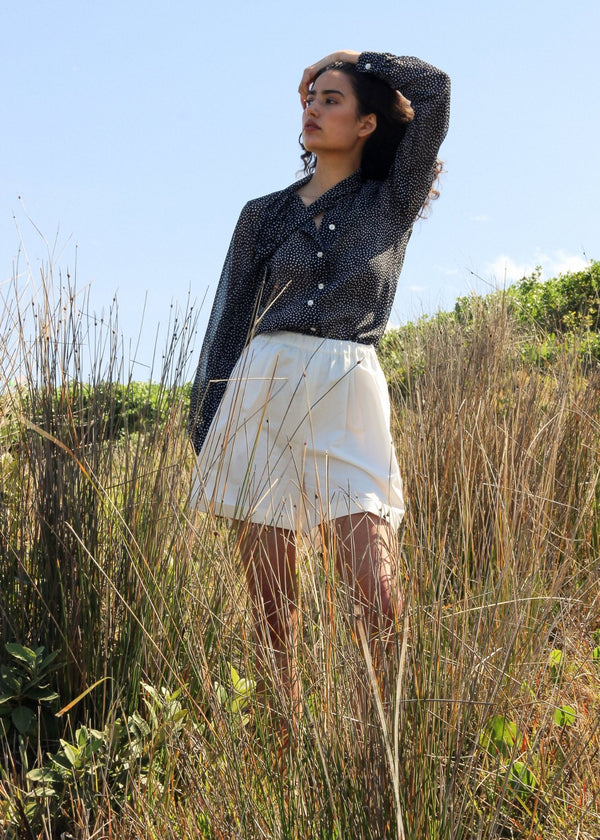 India wears the Carmen Pussy-bow Blouse in Dalmatian Front with Cosette Shorts, both from Laundromat
