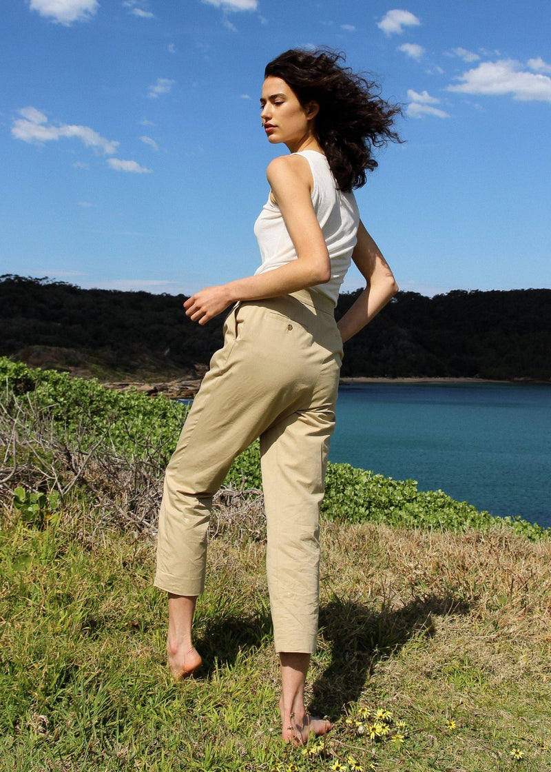 India on a hillside wearing the Cecil Singlet in Jasmine by Laundromat