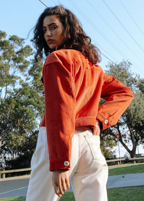 Back view of India wearing the Clementina Corduroy Jacket in Tangelo from Laundromat