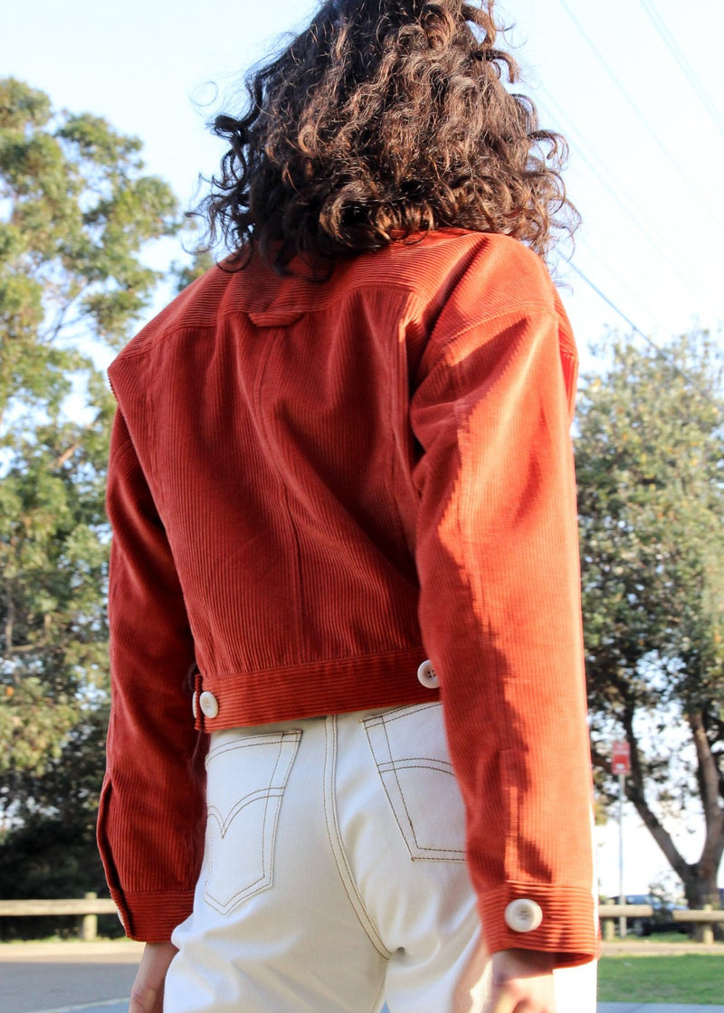 Back of the Clementina Corduroy Jacket in Tangelo from Laundromat, worn by India