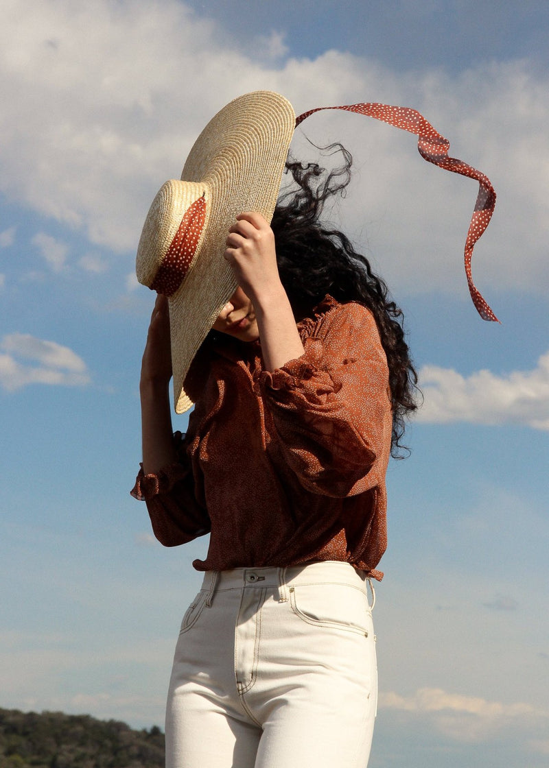 Marlo wears the Clothilde Straw Boater Hat in Anise Dot Ribbon Side with Helen Mom Jeans, both from Laundromat