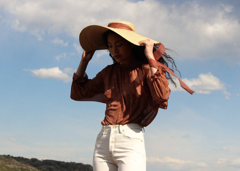 Marlo wears the Clothilde Straw Boater Hat in Anise Dot Ribbon from Laundromat