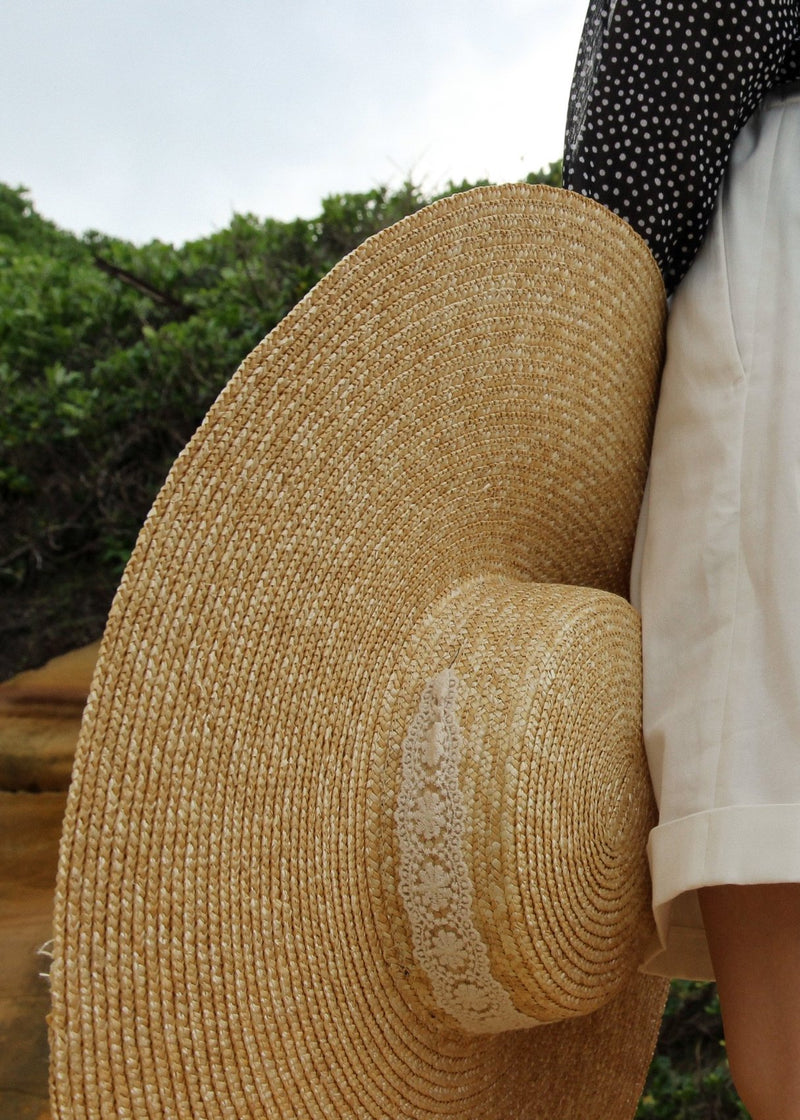 Lace ribbon detail of the Clothilde Straw Boater Hat in Seaside Daisy Lace by Laundromat