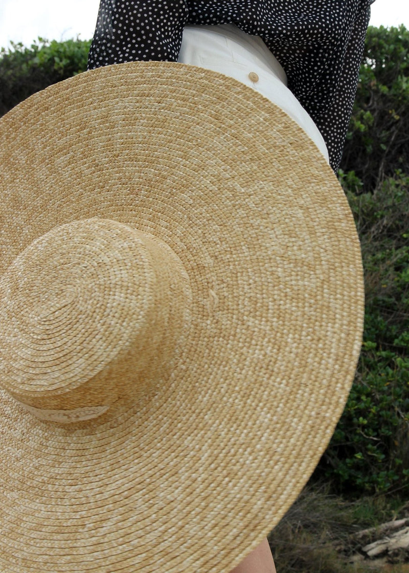 The Clothilde Straw Boater Hat in Seaside Daisy Lace, hand-made from wheat straw by Laundromat