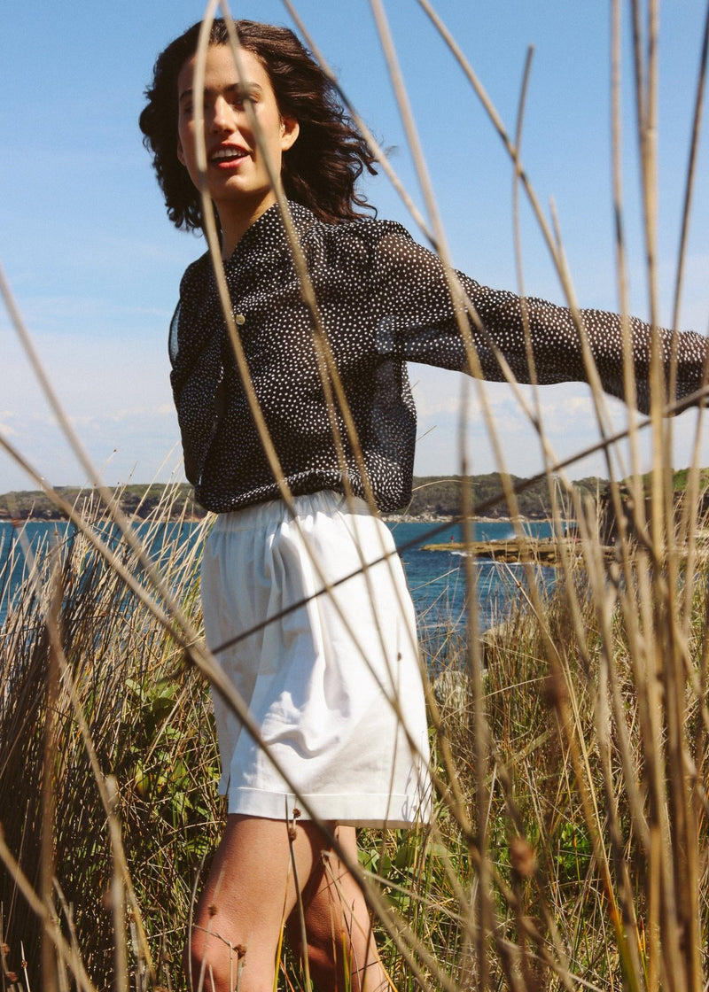 India in the reeds wearing the Cosette Shorts in Magnolia from Laundromat
