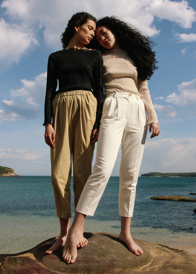 Marlo wears the Elaine Pleat Trousers in Alabaster Front from Laundromat