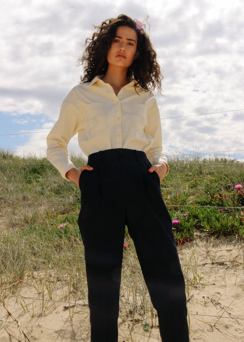 India with her hands in the pockets of the Elaine Pleat Trousers in French Navy from Laundromat