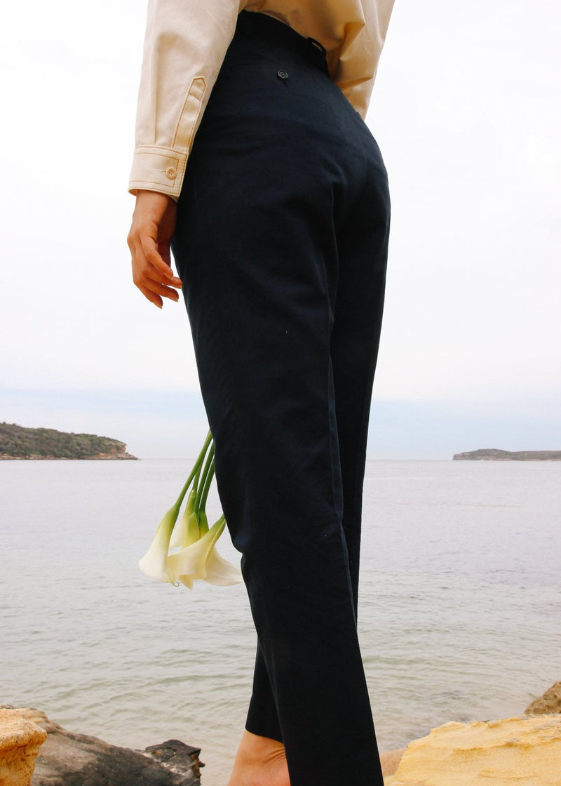 Back view of the Elaine Pleat Trousers in French Navy by Laundromat