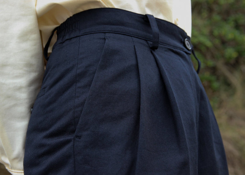 Front pleat detail of the Elaine Pleat Trousers in French Navy by Laundromat