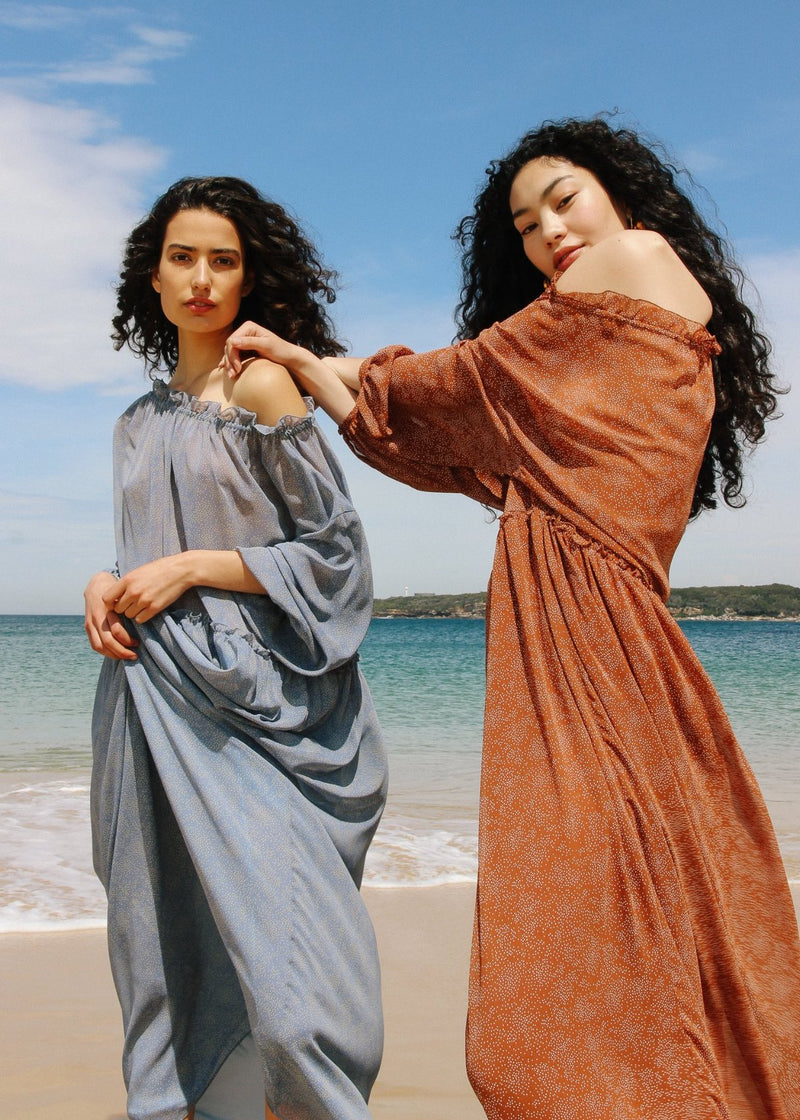 India and Marlo both wearing the Emmeline Dress off-the-shoulder from Laundromat