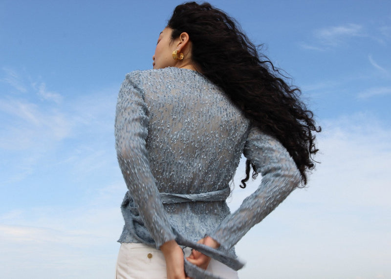Back detail of the Luela Fil Coupé-Plissé Wrap Top in Cornflower from Laundromat