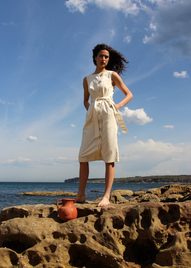 India by the sea in the Luna Denim Dress in Double Cream by Laundromat