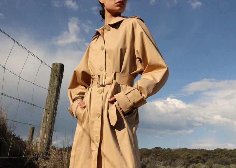 India with her hands in the pockets of the Marisol Trench Coat in Biscuit from Laundromat