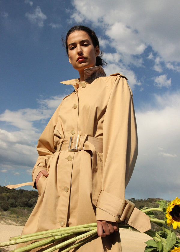 India holding sunflowers, wearing the Marisol Trench Coat in Biscuit from Laundromat