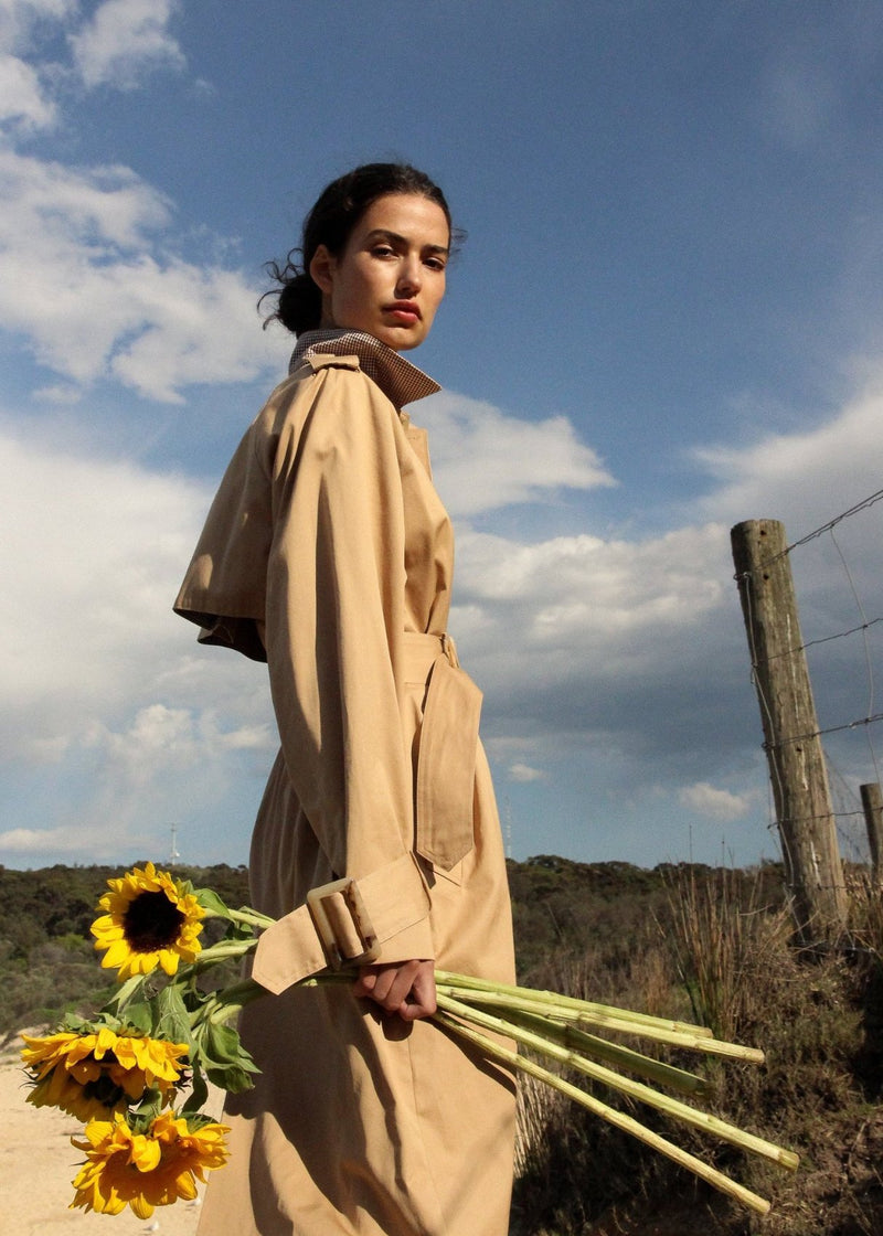 India wears the Marisol Trench Coat in Biscuit with back yoke from Laundromat