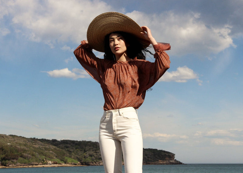 Marlo wears the Mireille Blouse in Cinnamon Poppyseed with the Helen Mom Jeans, both from Laundromat